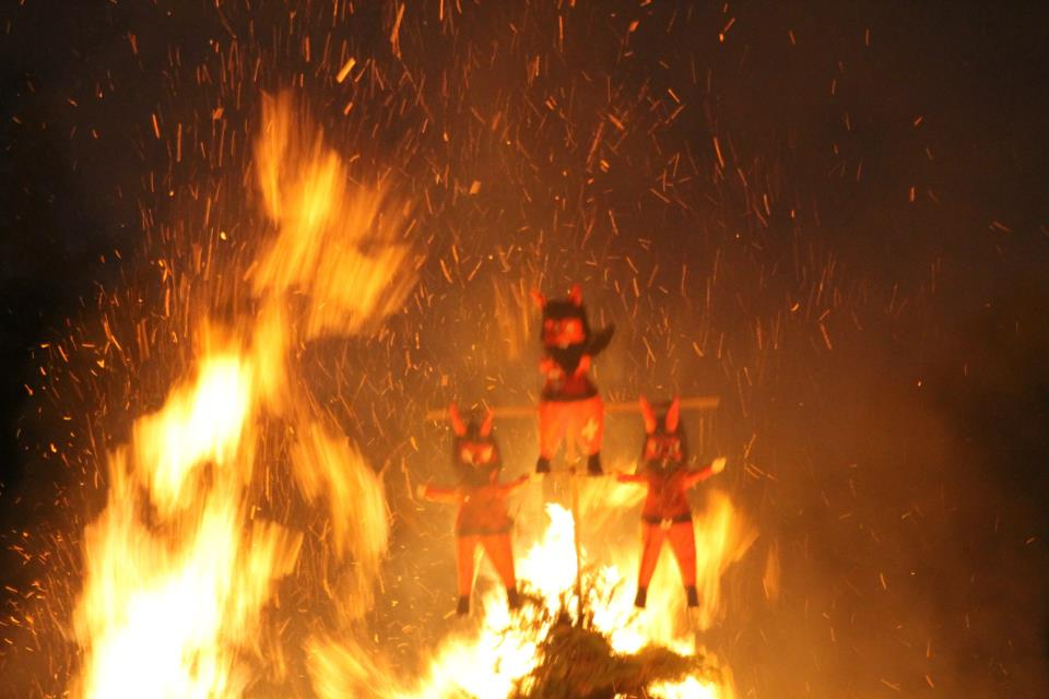 Paper Devils burning during the Quema del Diablo celebration in Guatemala's Hacienda Nueva Country Club.  Photo by Pedro Pepió. All Rights Reserved.