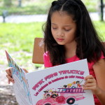 My daughter just loved Pink Fire Trucks and I am happy that she was reading a book that is teaching her so much. Photo: Paula Bendfeldt-Diaz. All Rights Reserved.