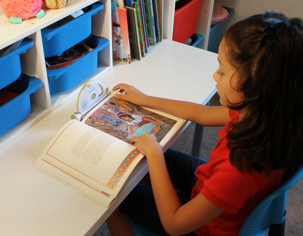 girl reading with sparkup reader