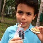 boy eating cookie and milk