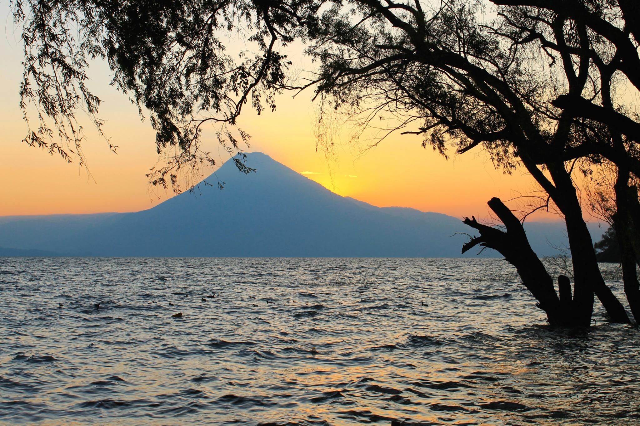 Sunset behind volcano in from the Santa Catarina Palopó dock in Lake Atitlan, Guatemala.
