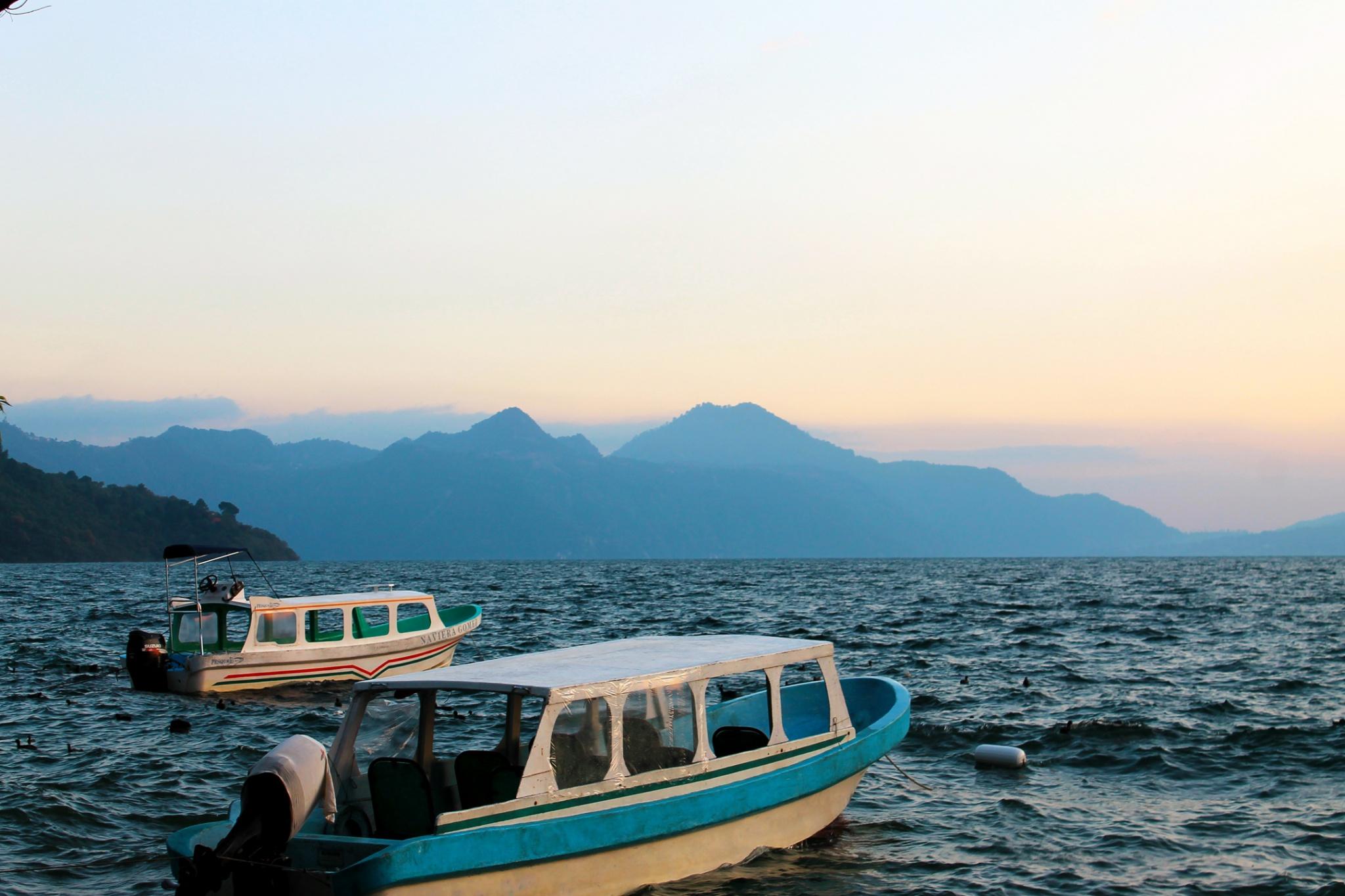 Small boats or lanchas on the shores of Lake Atitlan at sunset. Guatemlala.