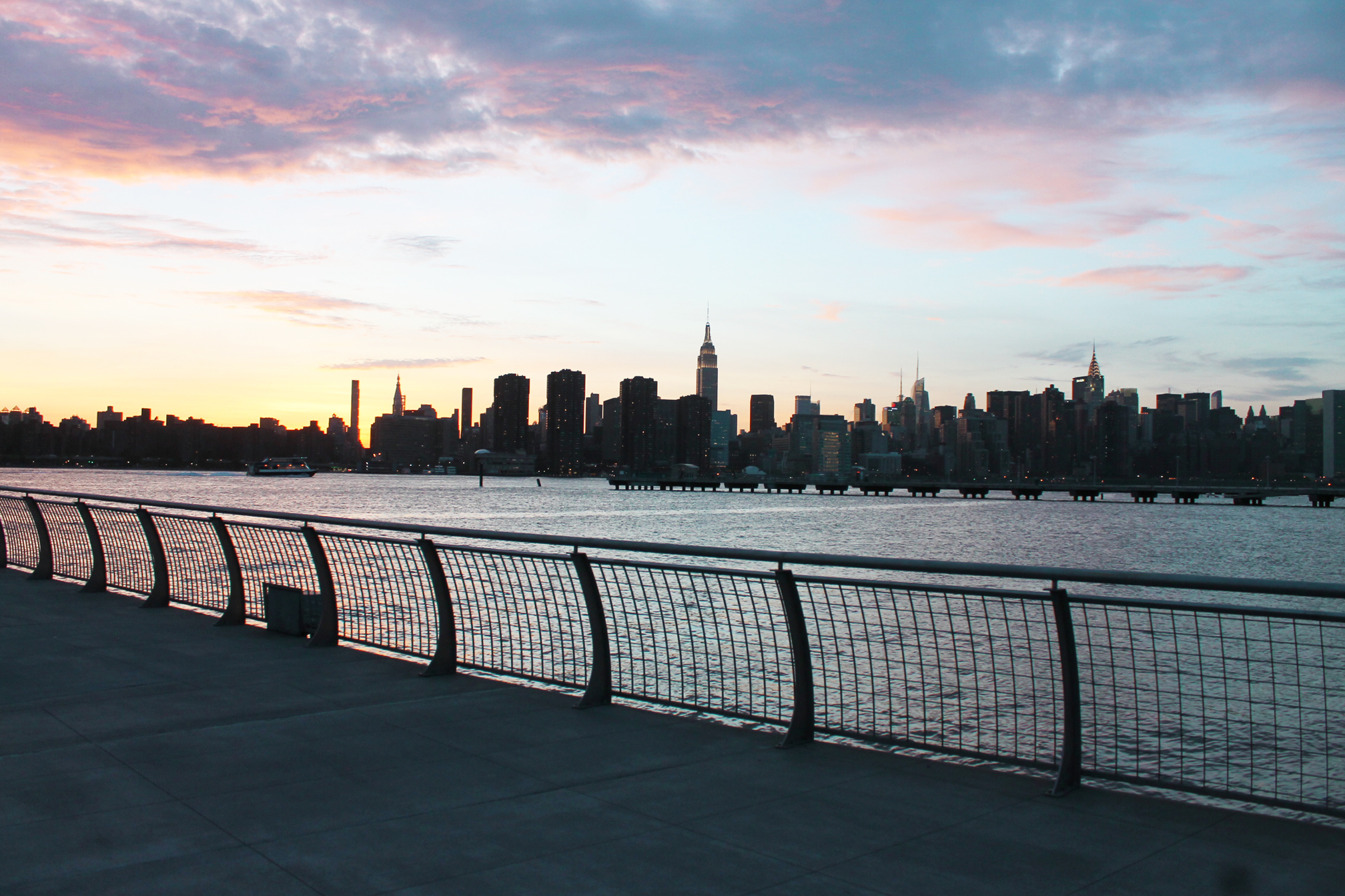 Sunset on Manhattan Skyline from Transmitter park Greenpoint Brooklyn