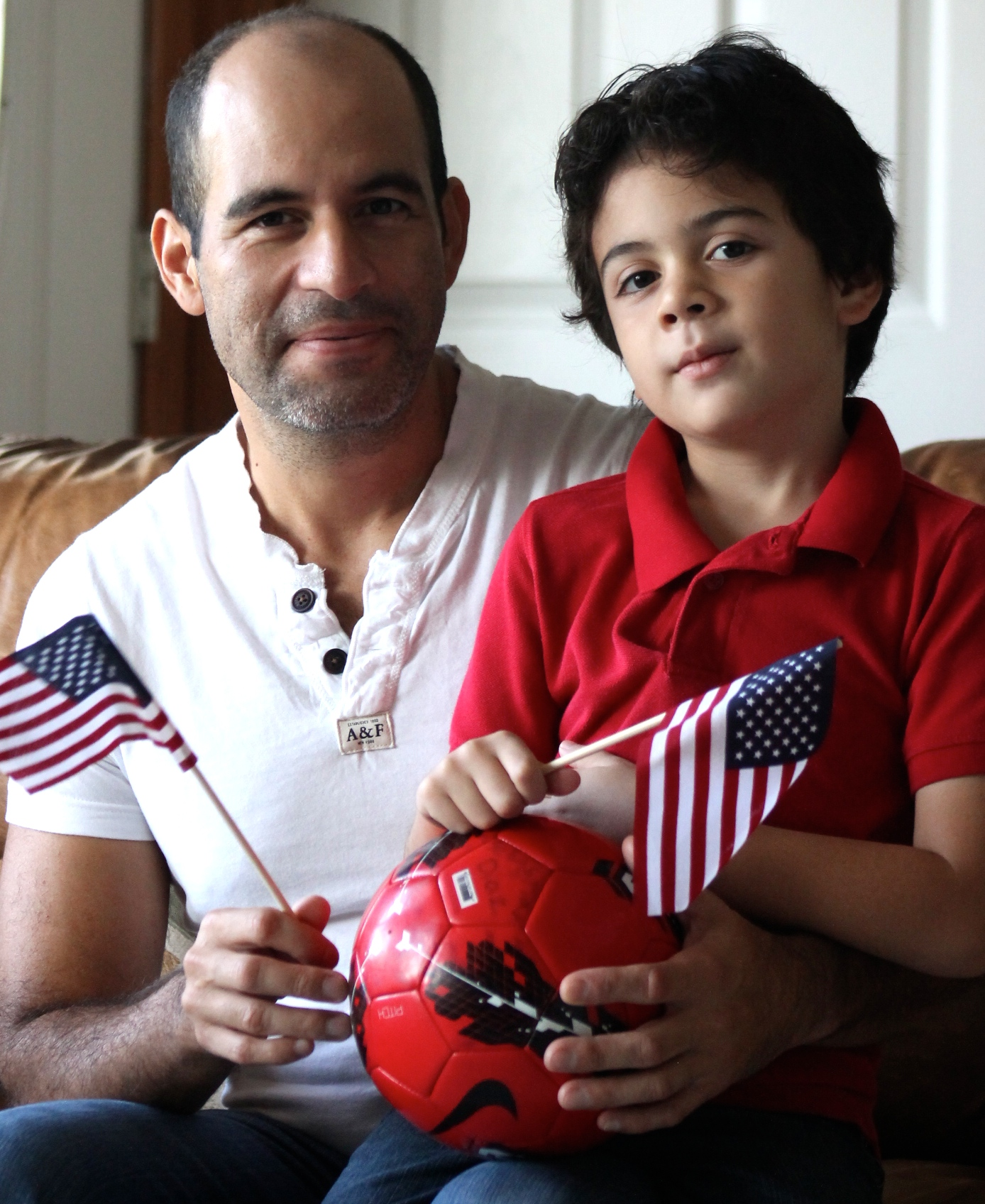 soccer Hispanic Latino boy and father USA
