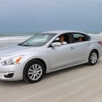Nissan Altima on the beach