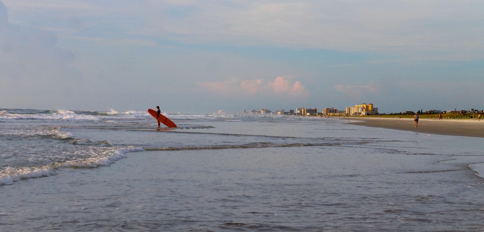 New Smyrna Beach surfer at sunrise