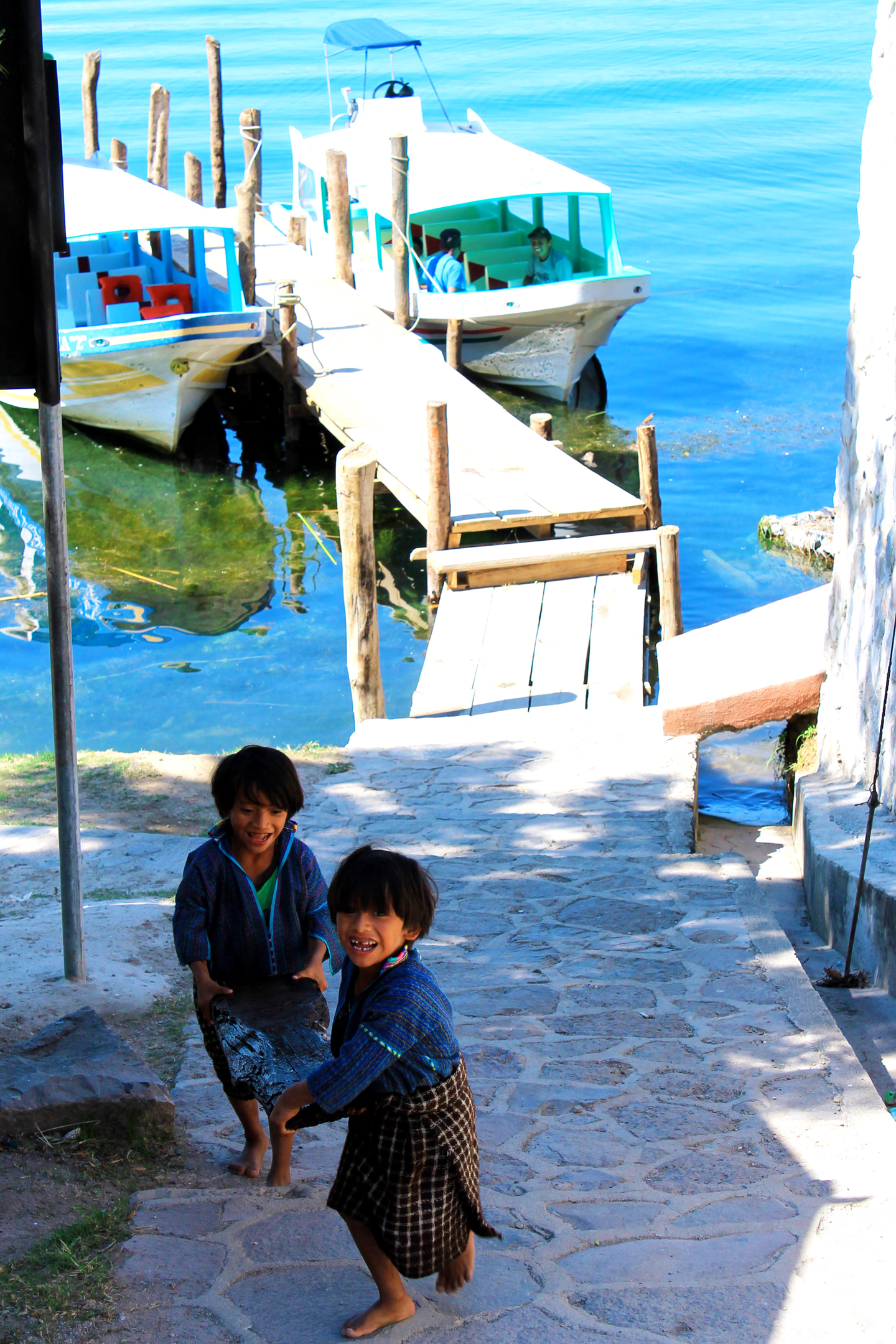 boys at dock in San Antonio Palopo in Lake Atitlan Guatemla