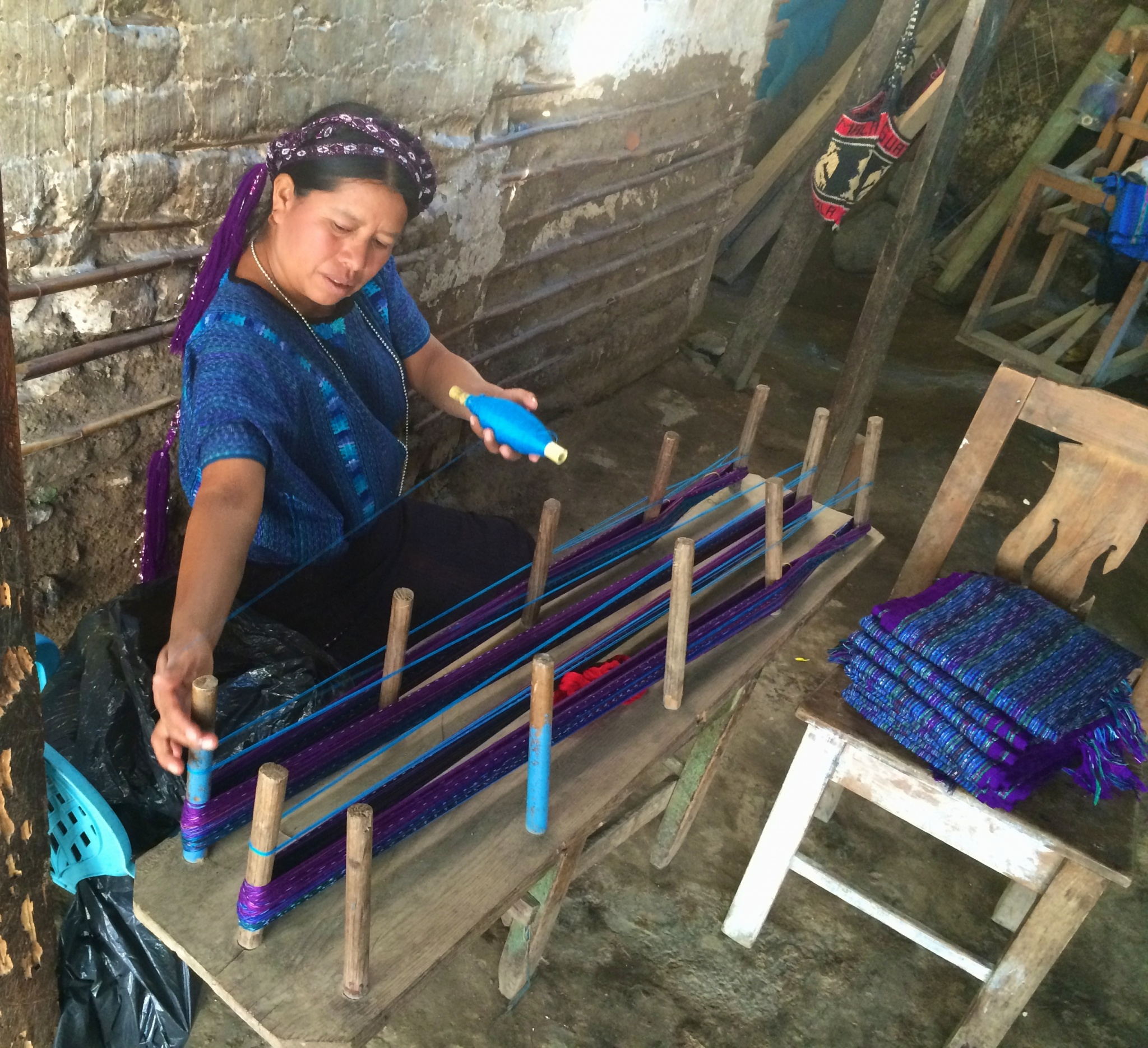Mayan woman winding the warp for weaving in San Antonio Palopo Guatemala