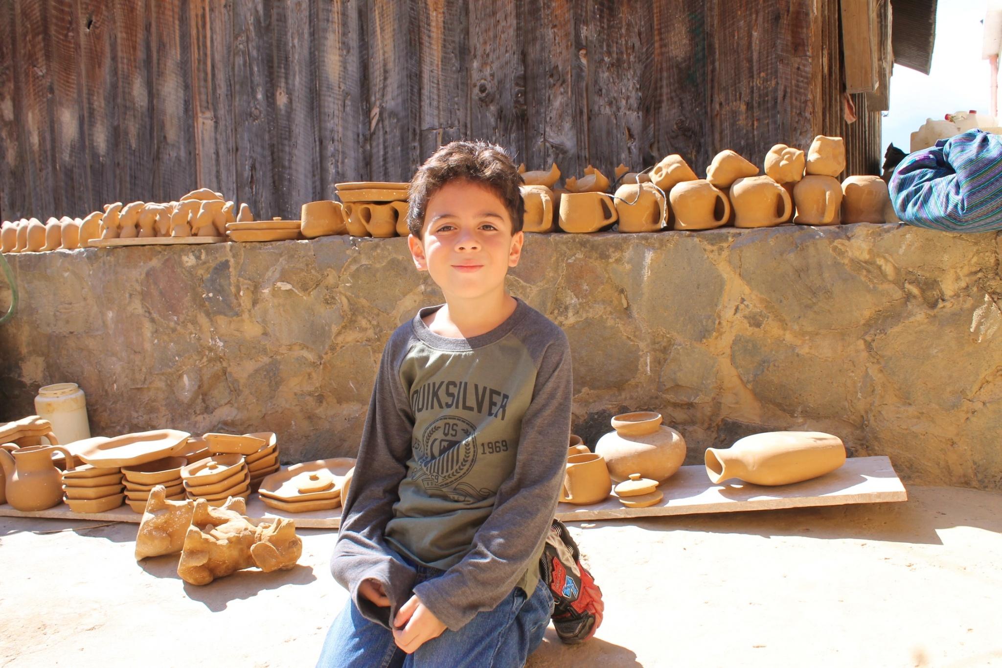 boy at clay workshop in San Antonio Palopo, Guatemalaa