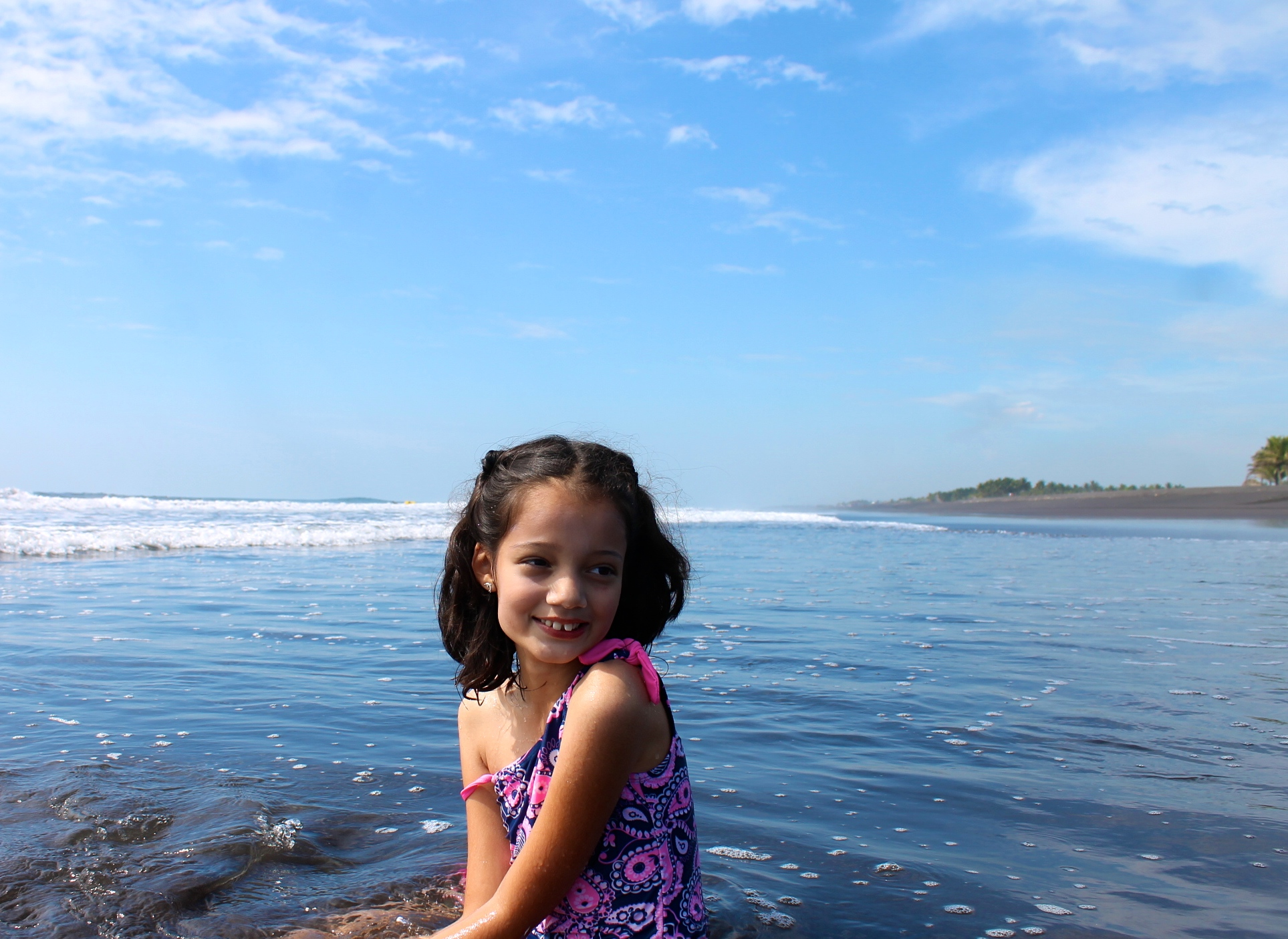 girl at the black sand beach in Guatemala