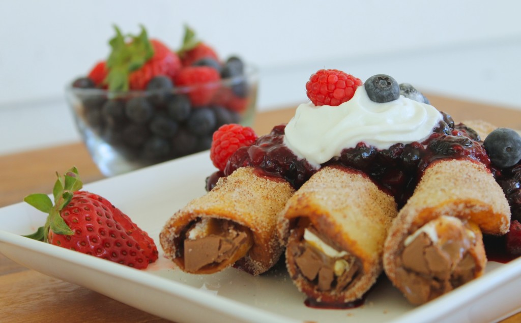 Chocolate tacos with berry sauce Snickers Almond