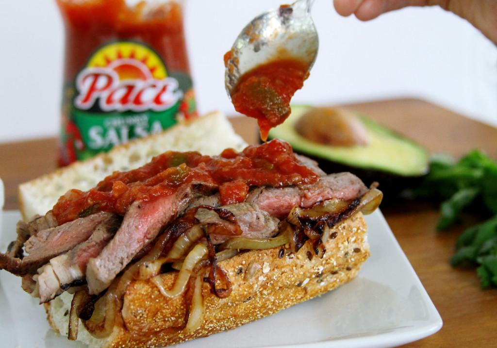 Adding Pace Salsa steak strips Bistec sandwich