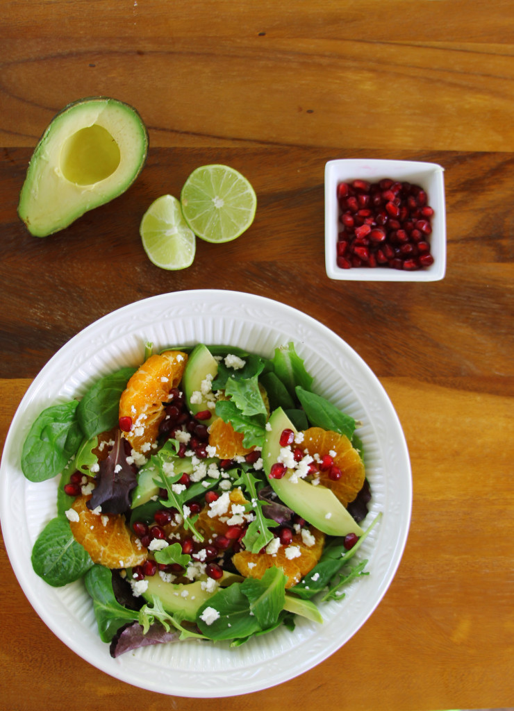 Avocado Tangerine salad with spicy vinaigrette top view