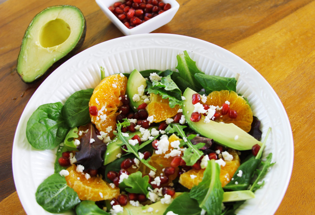 Avocado Tangerine salad with spicy vinaigrette top view three quarters