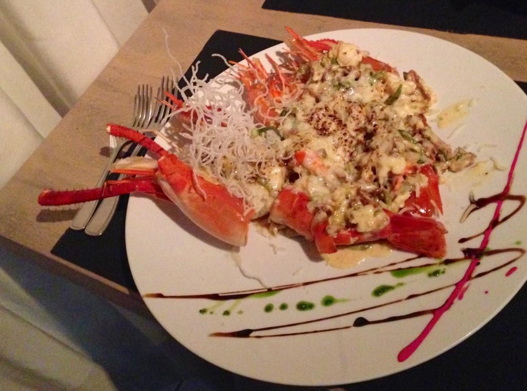 Shrimp au gratin with lorocos and inacates at Gracia Cocina de Autor in Guatemala City.