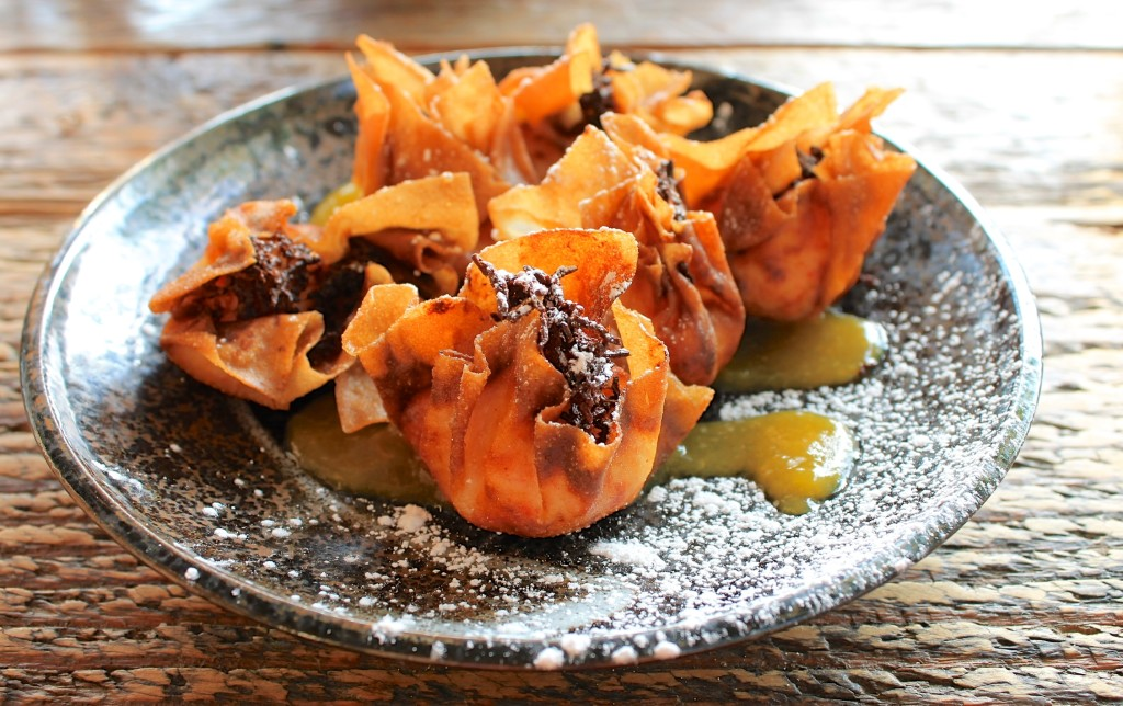 Dragonfly Sushi in Gainesville. Krab wontons with peach reduction. Photo: Paula Bendfeldt-Diaz