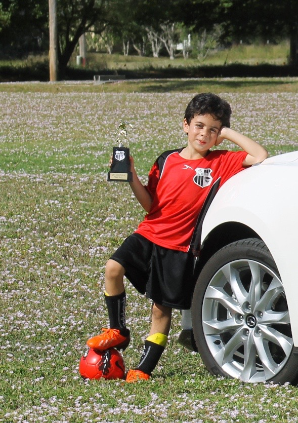 boy with soccer trophy