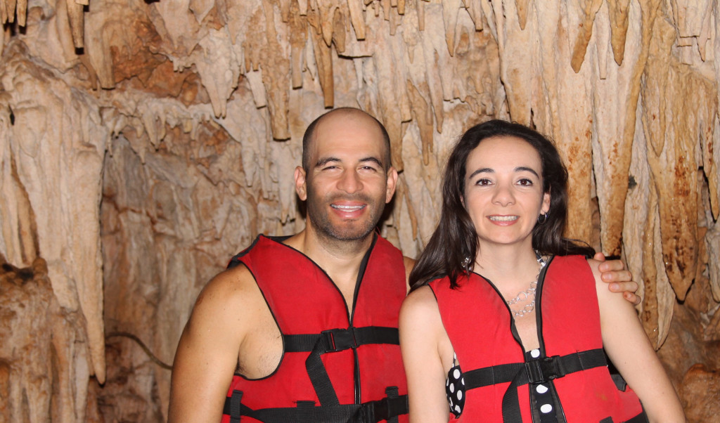 couple in vacation on a cave cave