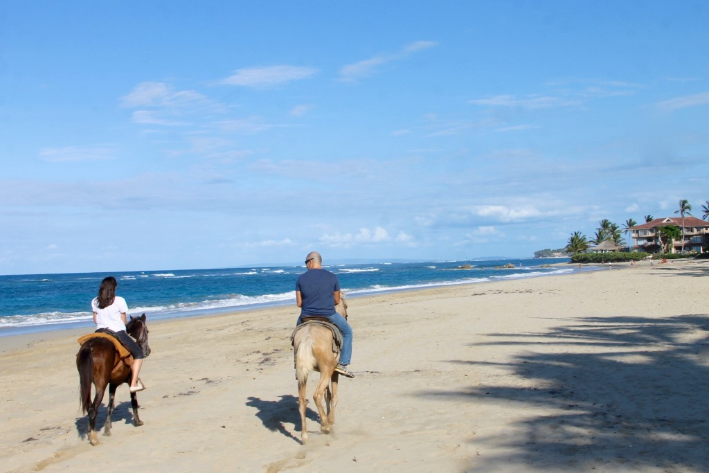 Riding horses on the beach in Puerto Plata Dominican Republic