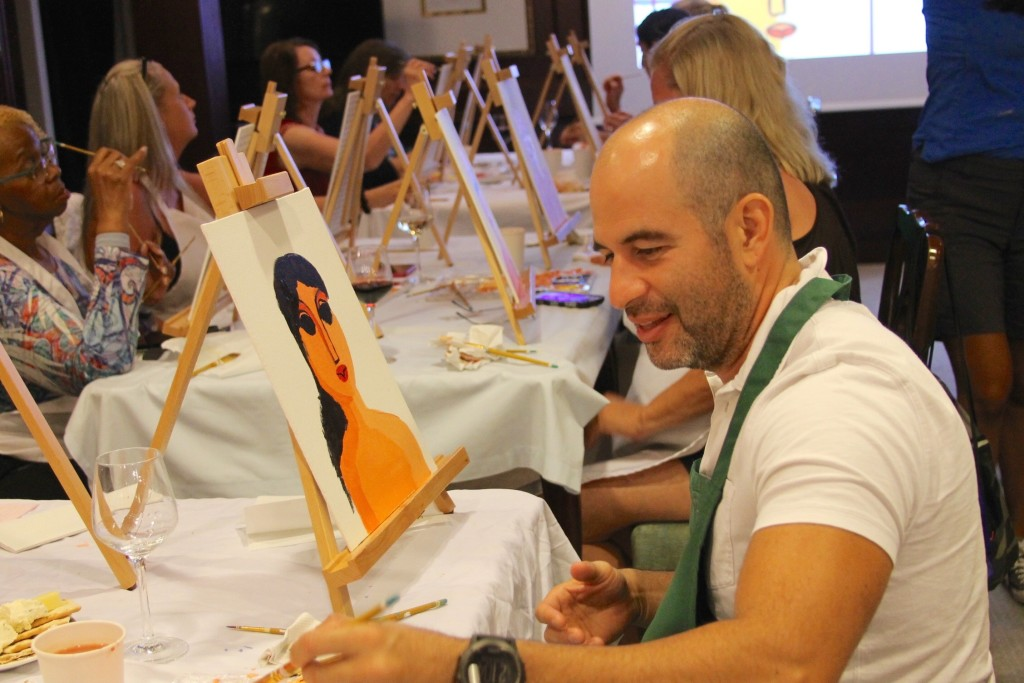 Paint and wine at Fathom's Adonia was focused in the Dominican culture