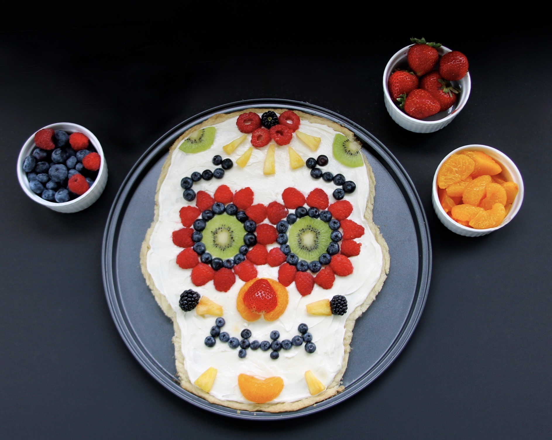 healthy day of the dead sugar skull fruit pizza - growing up bilingual