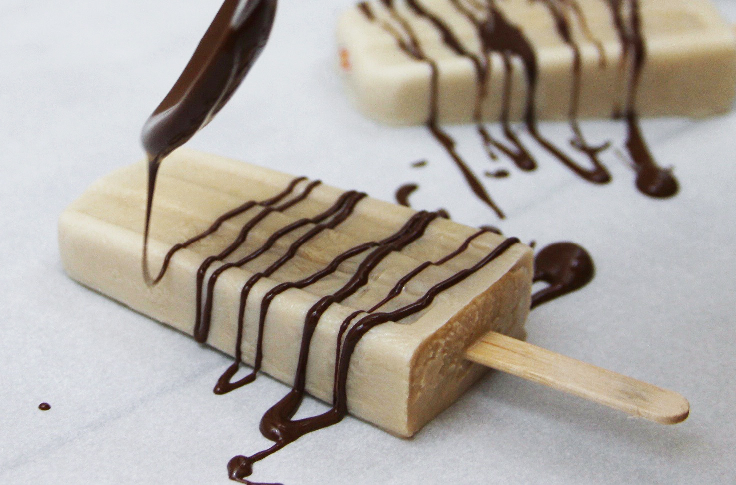 Caramel Latte Popsicles With Coconut And Chocolate Drizzle
